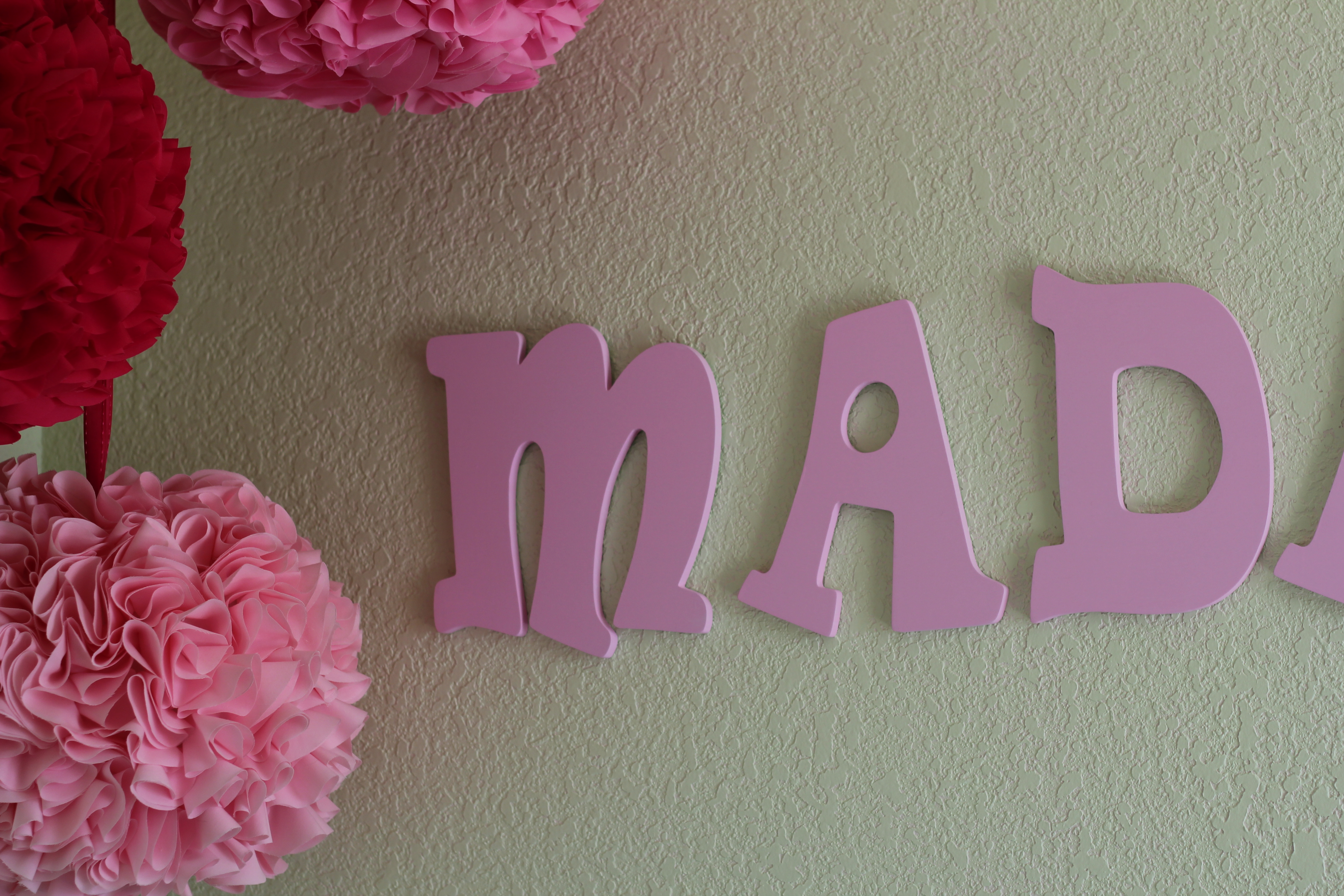 another change i made to maddys room since she was born is that i painted the wood letters spelling her name pink i love how it looks now